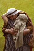 A Senior Man Hugging Another Person Both Dressed In Robes And Cloths On Heads — Stock Photo