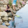 Two Girls Playing By The Water — Stock Photo