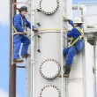 People Working At An Oil Refinery — Stock Photo #31761555
