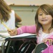 Stock Photo: Girl Sitting At Her Desk In Classroom