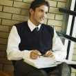 Stock Photo: Student In Uniform, Studying