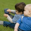 Two Boys Sitting On Grass — Stock Photo #31764185