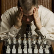 Stock Photo: MConcentrating On Chess Game
