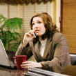 Stock Photo: BusinesswomTalking On Phone