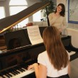 Teenage Daughter Playing The Piano For Her Mother — Stock Photo