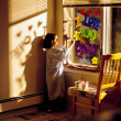 Little Girl Painting 'i Love You Daddy' On Window — Stock Photo #31768999