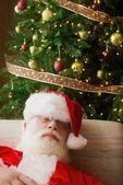 Santa Claus, Asleep In Front Of Christmas Tree — Stock Photo