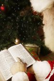 Santa Reading The Bible — Stock Photo