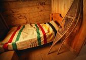 Historical Bedroom With Hbc Blanket And Snowshoes — Stock Photo