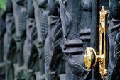 Golden Doorknob On Cast-Iron Gate — Stock Photo
