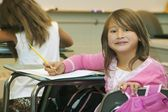 Girl Sitting At Her Desk In The Classroom — Photo