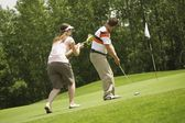 Couple Golfing Together — Stockfoto