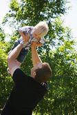 Man Holding Child — Stock Photo