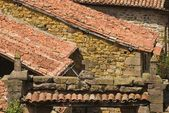 Stone Cross On Lintel With Pantiled Roofs, Carmona, Cantabria, Northern Spain — Stock Photo