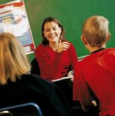 A Teacher With Students In A Classroom — Stock Photo