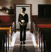 Front View Of A Woman Standing In Church — Stock Photo