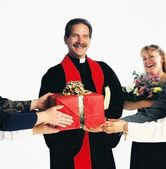 Priest Receiving Gifts — Stock Photo