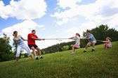 Tug Of War Between Parents And Kids — Stock Photo