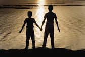 Two Boys At The Water's Edge — Stock Photo