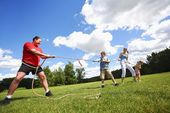 Tug Of War Between Dad And Kids — Stock Photo