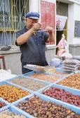 Man Selling Nuts And Dried Fruit In Dunhuang, China — Stock Photo