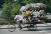Man Hauling A Load Of Bags On A Cycle Rickshaw In Beijing, China — Stock Photo