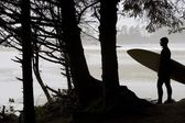 Silhouette Of A Surfer Looking Out To The Water — Stock Photo