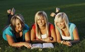 Three Girls Reading Together — Stock Photo