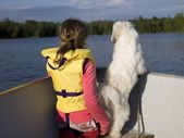 Girl And Dog On A Boat — Stock Photo