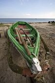 Boat on a beach — Stockfoto