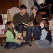 Family Reading A Story At Christmas Time — Stock Photo #31793529