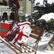 Christmas Gifts On A Park Bench — Stock Photo #31794497