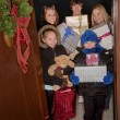 Stock Photo: Kids Delivering Christmas Gifts