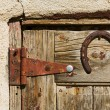 Horse Shoe On Old Wooden Door — Stock Photo