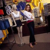 Woman Standing Next To Mannequin — Stockfoto