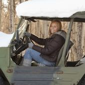 Woman In A Snow Covered Vehicle — Stock Photo
