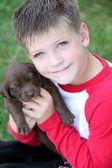 Boy Holding Puppy — Stock Photo