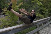 Man Stretching On Bridge, Bracebridge, Ontario, Canada — Stock Photo