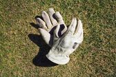 Work Gloves Tossed On A Lawn — Stock Photo