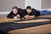 Father And Son Playing With Racetrack — Stock Photo