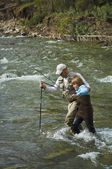 Father And Son Crossing A Mountain Fly Fishing River — Stock Photo