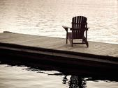 Lake Of The Woods, Ontario, Canada. Empty Deck Chair On A Pier Next To A Lake — Stock Photo