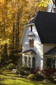 House in autumn — Stock Photo