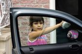 Girl Cleaning Car Window — Stock Photo