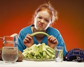 Women With Plate Of Celery And Sports Equipment — Stock Photo
