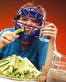 Woman In Sports Equipment Eating Celery — Stock Photo