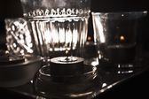 Lit Candles And Glassware — Stock Photo