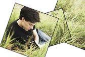 Adolescente, leyendo en la hierba — Foto de Stock
