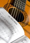 Guitar And Book Of Music — Stock Photo