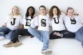 Five Teenagers With T-Shirts Spelling Jesus — Stock Photo